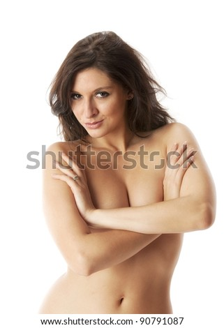 Beautiful topless woman smiling and covering her breasts on white background