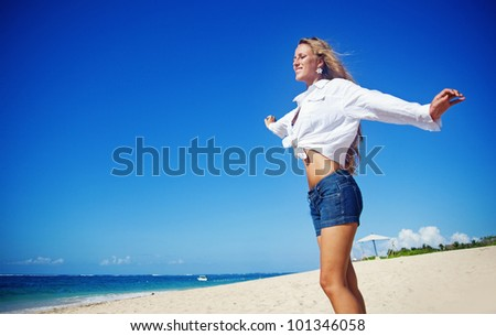 Beautiful tourist woman on summer vacation, beach, bali