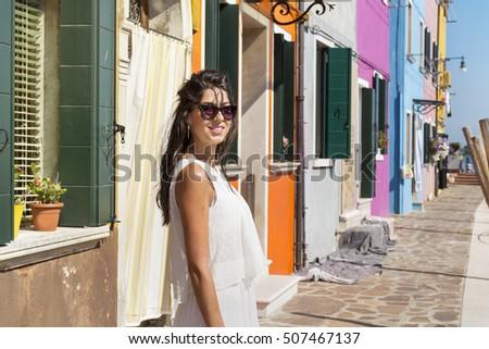 beautiful tourist woman with white dress  walking  in Burano ,Italy - Shutterstock ID 507467137
