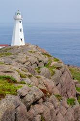 Beautiful Tower Lighthouse on High Cliffs Over Ocean