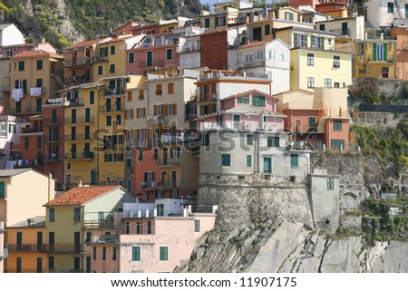 beautiful town of Corniglia in cinqueterre in Italy with many colorful houses perched on a cliff