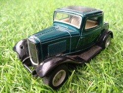 Beautiful toy car on the grass