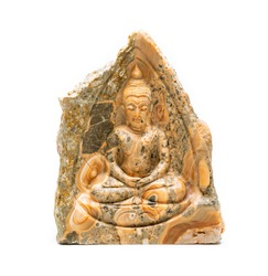 Beautiful traditional Buddha carved from single block of limestone on white background.