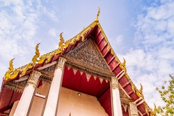 Beautiful traditional Thai pattern carved on the wood of the Buddhist temple tympanum