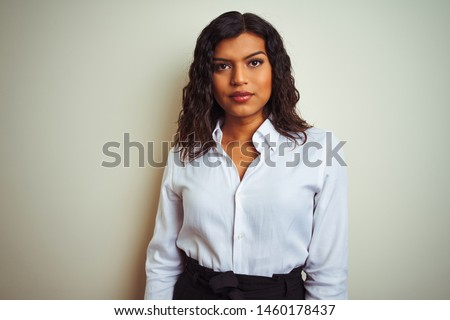 Beautiful transsexual transgender elegant businesswoman over isolated white background with serious expression on face. Simple and natural looking at the camera.