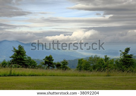 Beautiful trees, mountains and skies located on the Blue Ridge Parkway in the mountains of the Southeastern United States - stock photo