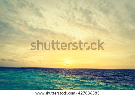Beautiful tropical beach and sea at sunset times in maldvies island - Vintage Filter #427836583