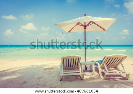 Beautiful tropical beach and sea landscape with coconut palm tree and umbrella and chair - vintage Filter and Boost up color Processing #409681054