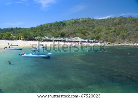 Beautiful tropical beach in Huatulco, Oaxaca, Mexico - stock photo