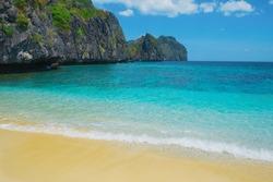 Beautiful tropical beach. Scenic landscape with sandy beach sea and mountain island, El Nido, Palawan, Philippines, Southeast Asia. Sea bay scenery. Popular landmark tourist destination of Philippines