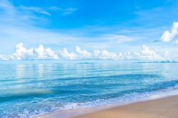 Beautiful tropical beach sea ocean with white cloud blue sky and copyspace for leisure travel in holiday vacation concept