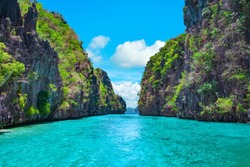Beautiful tropical blue lagoon. Scenic landscape with sea bay and mountain islands, El Nido, Palawan, Philippines, Southeast Asia. Exotic scenery. Popular landmark, famous destination of Philippines