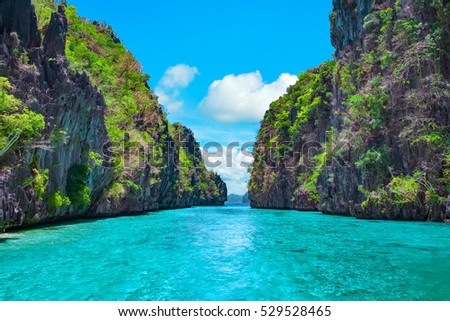 Beautiful tropical blue lagoon. Scenic landscape with sea bay and mountain islands, El Nido, Palawan, Philippines, Southeast Asia. Exotic scenery. Popular landmark, famous destination of Philippines #529528465