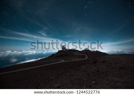 Beautiful Tropical Island Paradise Scenic View From Top of Haleakala Volcano Mountain with Night Sky and Observatory in Landscape Background of Blue Starry Sky in Maui Hawaii