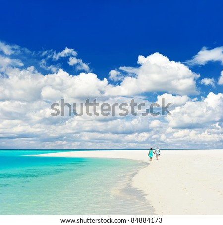 beautiful tropical landscape. senior couple walking on a beach