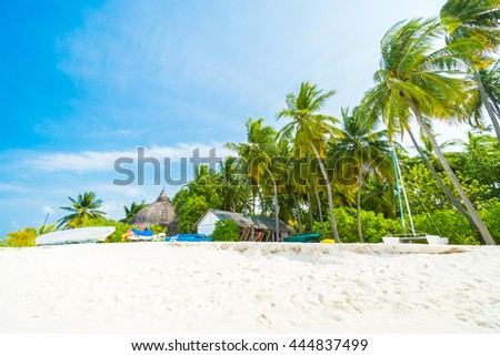 Stock Photo Beautiful tropical Maldives resort hotel and island with beach and sea  and coconut palm tree on sky for holiday vacation background concept - Boost up color Processing