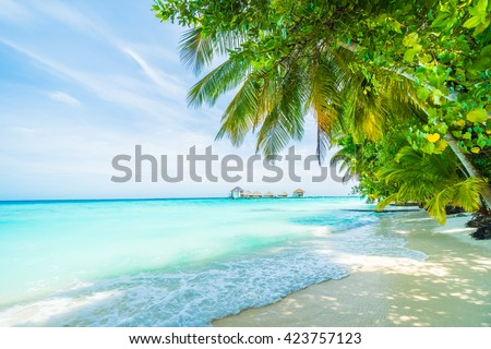 Beautiful tropical Maldives resort hotel and island with beach and sea on sky for holiday vacation background concept - Boost up color Processing #423757123