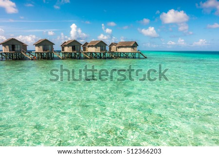 Beautiful tropical Maldives resort hotel with beach and blue water #512366203