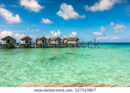 Beautiful tropical Maldives resort hotel with beach and blue water #527563807