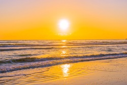 Beautiful tropical nature beach sea ocean with sunset or sunrise for travel vacation