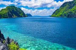 Beautiful tropical sea bay. Scenic landscape with mountain islands and blue lagoon, El Nido, Palawan, Philippines, Southeast Asia. Exotic scenery. Popular landmark, famous destination of Philippines