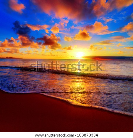 Beautiful tropical sunset on the beach - stock photo