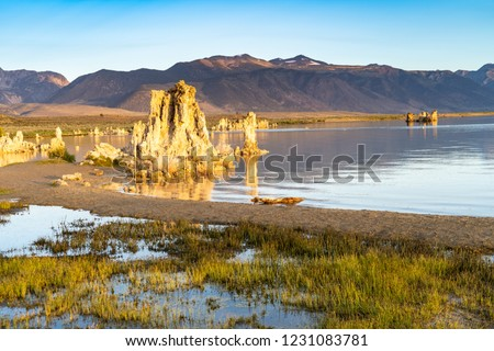 Beautiful tufa formations at Mono Lake with calm waters during sunrise. Eastern Sierra Nevada California