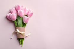 Beautiful tulips for Mother's Day on light background, top view