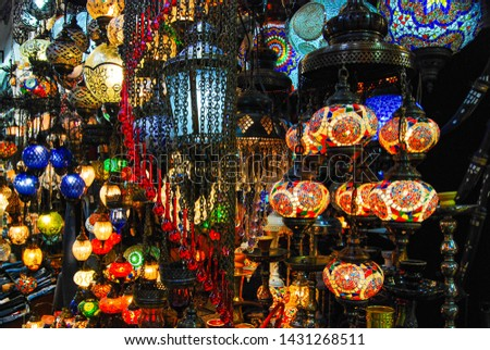 Beautiful Turkish lanterns in assortment of rich and bright colors shining brightly in a bazaar #1431268511