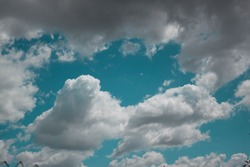 Beautiful turquoise blue sky with white and gray clouds.  Sunny air summer weather cloudscape heaven up sky view