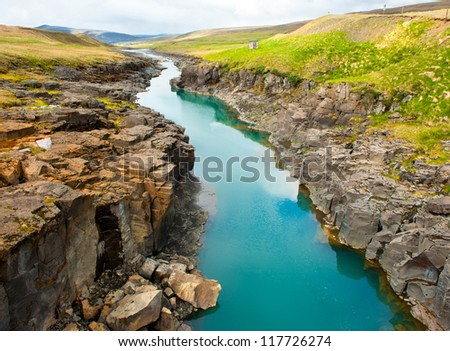 Beautiful turquoise glacial river in a canyon, Iceland