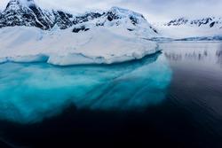 Beautiful turquoise ice below surface glacier in Antarctica