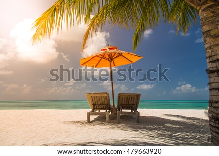 Beautiful turquoise sea, deckchairs, white sand and palms, sun, very beautiful summer nature background. Luxury travel holiday vacation background concept. #479663920