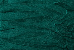 Beautiful turquoise stains of liquid nail polish,fluid art technique.Monochrome marble background.Liquid stripy paint texture.Nail laquer flow modern backdrop.Minimalistic concept.Copy space.