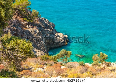 Beautiful turquoise water of the Mediterranean Sea off the rocks. Fethiye, Turkey