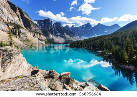 Shutterstock Beautiful turquoise waters of the Moraine lake with snow-covered peaks above it in Banff National Park of Canada