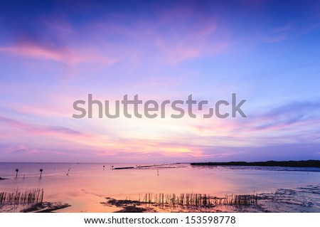 Beautiful twilight silhouette sunset at tropical sea in Thailand. #153598778