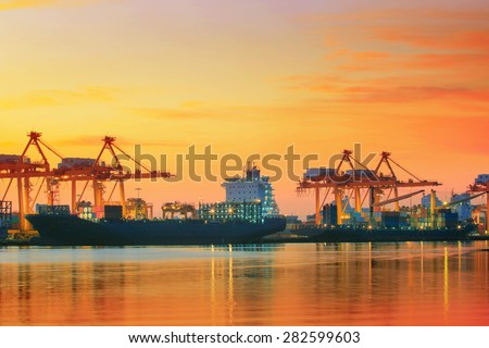 beautiful twilight sky at shipping port use for vessel ,nautical import and export transport logistic industry