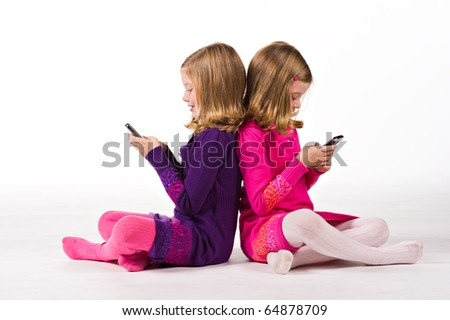 Beautiful twin sisters send text messages