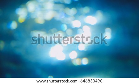 Stock Photo Beautiful underwater sea scene view with natural light rays, shining through the water's glittering and blurred bokeh