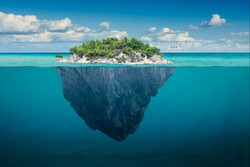 Beautiful underwater view of lone small island above and below the water surface in turquoise waters of tropical ocean.