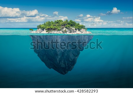Stock Photo Beautiful underwater view of lone small island above and below the water surface in turquoise waters of tropical ocean.