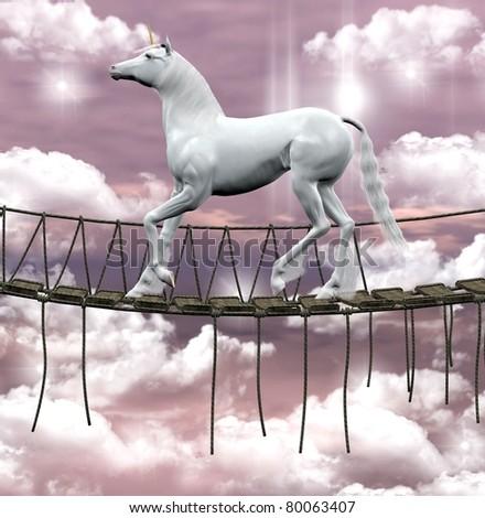 Beautiful unicorn on an old wooden bridge - stock photo