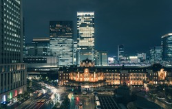 Beautiful urban cityscape with Tokyo station under twilight sky and neon night in Marunouchi business district, Japan