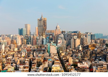 Beautiful urban skyline of vibrant Macao City on a sunny summer day, with the famous landmark luxury Grand Lisboa Hotel & Casino standing among modern buildings under blue clear sky, in Macau, China