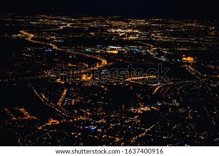 Beautiful urban skyline with colourful city illuminations
