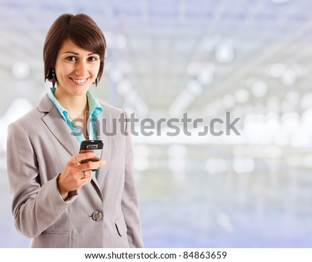 Beautiful using a cell phone - stock photo
