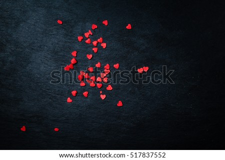 Beautiful valentines day background with red hearts on black background