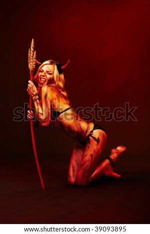 Beautiful vampire devil with trident  on deep red black - stock photo