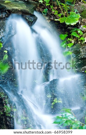 Beautiful veil cascading waterfalls, mossy rocks